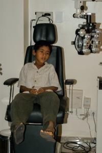 Boy in Eye Exam Chair